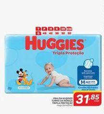 Oferta de Fraldas Huggies turma de mônica tripla proteçao mega (tamanhos) por R$31,85